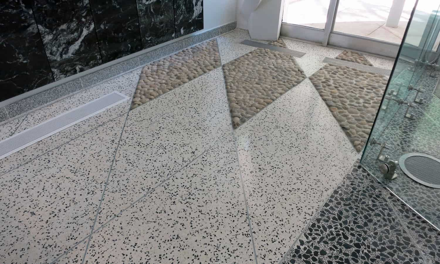 Dark and light terrazzo flooring in the lobby is similar to the dark and light exposed aggregate of the pre-cast concrete facades