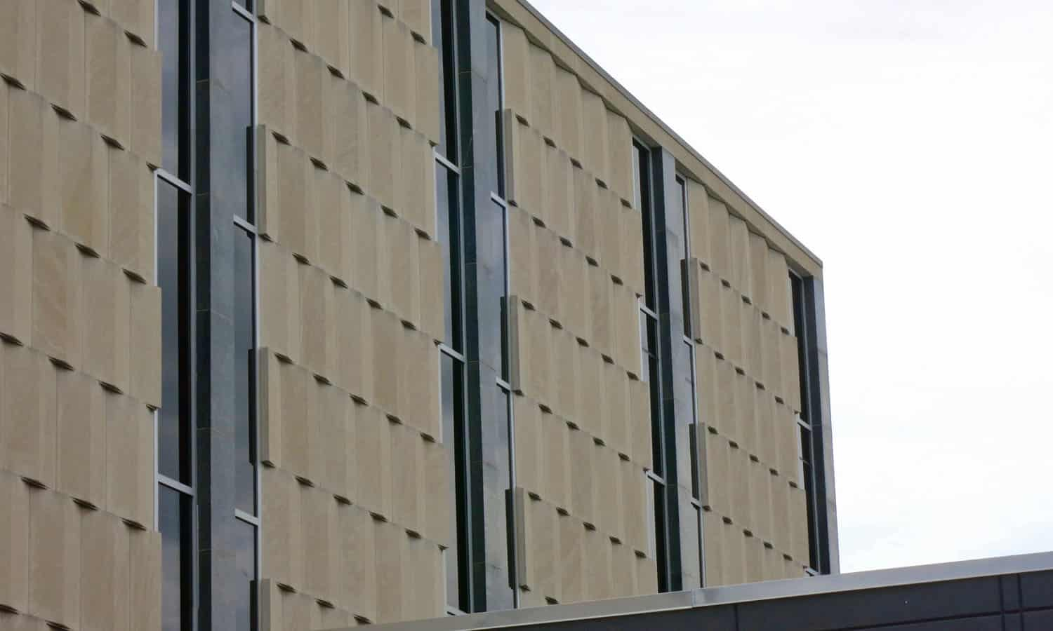 The sophisticated limestone-clad curtain wall of the justice building