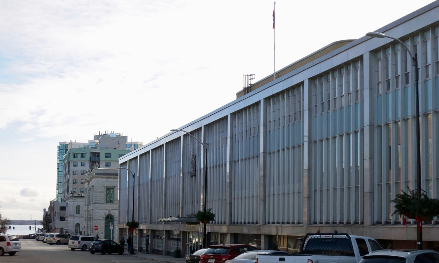 The monumental main facade runs the entire length of the block along Clarence St.
